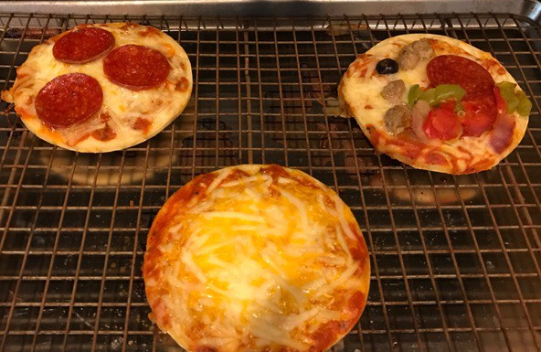 baked pizzas